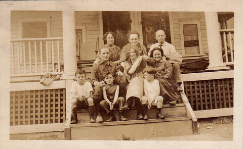 Three families on porch of the summer house