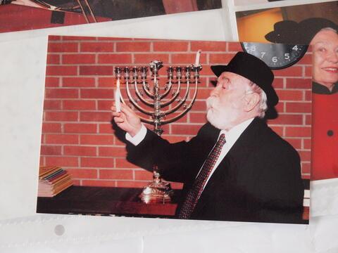 Moshe Kraus Lighting Hanukkah Candles