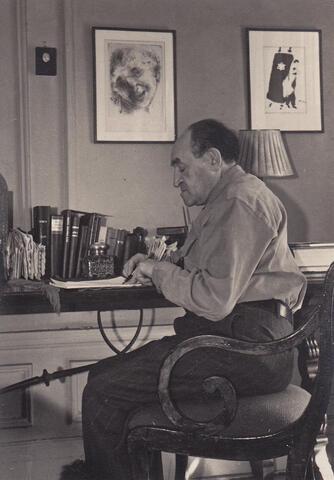 Yosef Opatoshu writing at desk