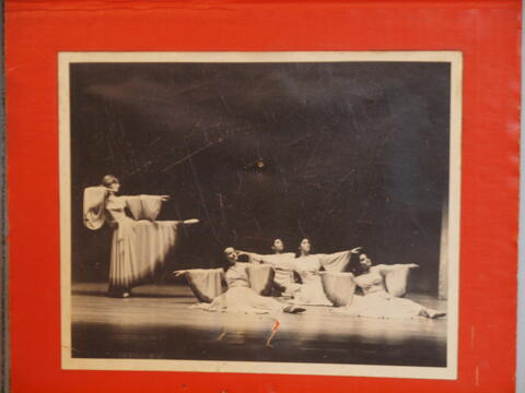 Photograph of Group Dance Performance, Four Seated Performers and One Standing