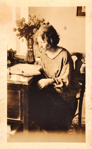 Adela at desk