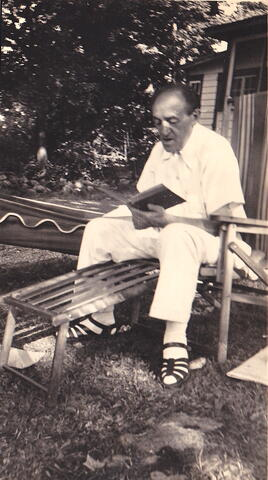 Yosef reading on lawn