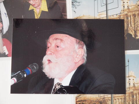 Moshe Kraus Singing into a Microphone