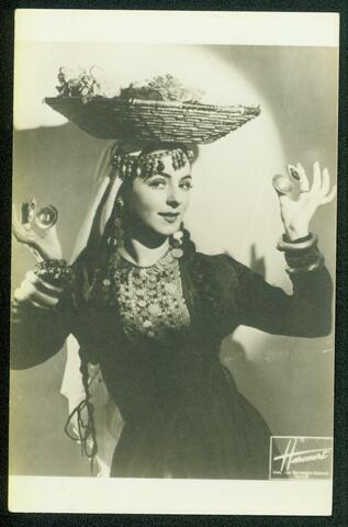 Photo of Noami Performance with Basket Balanced on Her Head