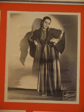 Noami Performing Dance in a Gown and Shawl