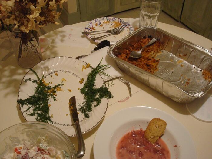 Aftermath of a feast, with leftover cheese pudding, strawberry borscht, cookies, farmer's salad.