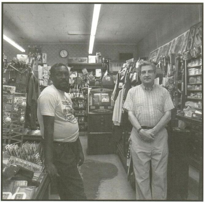 Robert Hirsberg and Marvin Joe Sawyer in Hirsberg's drugstore, Friar's Point, surrounded by merchandise