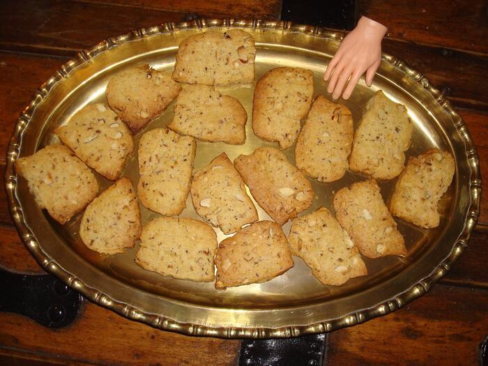 Ice box cookies on a golden platter with toy hand.