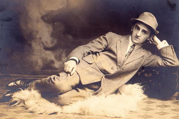 Yiddish writer Joseph Opatoshu lounging on a fur rug