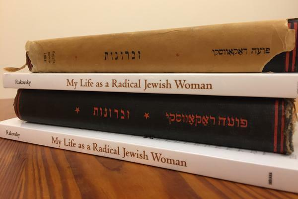 A stack of Yiddish books and their English translations by Puah Rakovsky.